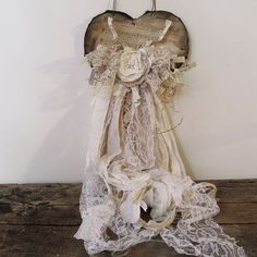 Romantic farmhouse tattered heart wall hanging torn dyed shabby vintage fabrics ornate cream white rose center home decor anita spero design