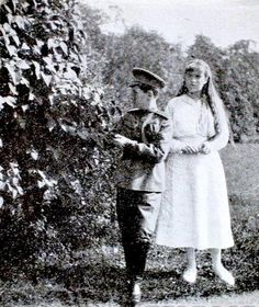Grand Duchess Anastasia Nikolaevna Romanov walking with her younger brother, Tsarevich Alexei Nikolaevich Romanov.