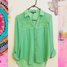 Mint button up blouse with sheer floral lace just above chest, five buttons.