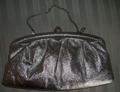Classy little vintage silver clutch bag with chain that slips inside. Silver kiss clasp knob resembles an acorn. Tan lining is in good condition with minor wear. Bridesmaid Clutches, Silver Clutch, Vintage Silver, Clutch Bag, Buy And Sell, Chain, Metal, Handmade, Bags