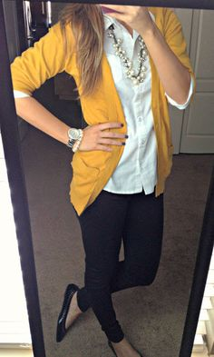 Have: mustard cardigan, white blouse, black jeans, necklace Need: plain black flates