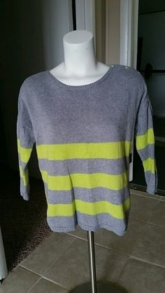 Size small. Super cute with buttons on 1 shoulder. Bright yellow and grey. Has some little fuzzies but still in great cond...