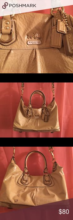 Coach satchel bag! Coach leather bag! Patent tan leather exterior. Lavender silk interior. Gold buckles and logo. Multi logos hardwear chains. This has been used. Has minor wear but no tear. Does have stains, the patent tan leather is very fragile. Picture 3 and 5 show where the damage is! In the back side of purse and bottom area. Not sure how it happened but does not come off. There will be a 30 to 35% off discount when you bundle 2 bags or more!! Open to reasonable offers‼️ Coach Bags…