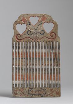 "Fine Love Token Braid Loom, The Shaped Cresting and Pierced Triple Heart Motif Hand Carved Birchwood with Original Painted Decoration, Carved and Dated ""1797"", Scandinavian, c. 1797. 11 ¼"" high x 6 ½"" wide x ¼"" deep. British and European Folk Art, available at Robert Young Antiques"