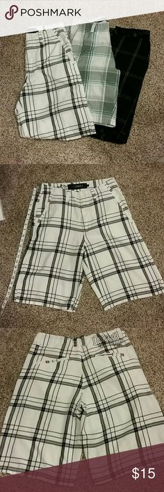 O'neil mens shorts 2pr and ocean current 30 Black and white checker pair are O'neil and the other is Ocean Torrent.  All buttons and zippers in working order.  The white oneil pair is super soft but has a little discoloration in the belt area. Whoever wore it must have used a black belt. These are great shorts and summers coming soon. O'Neill Shorts