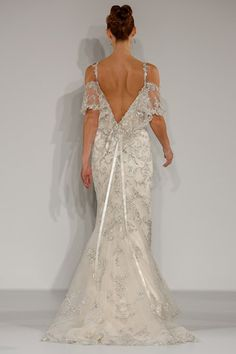 The deep V is sexy, but the soft frill and beading detail keep this Maggie Sottero dress ultra-feminine.