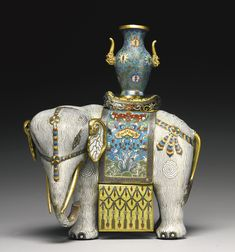 A CLOISONNE-ENAMELED FIGURE OF AN ELEPHANT,QING DYNASTY, QIANLONG / JIAQING PERIOD. Sotheby's