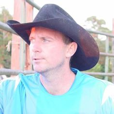 a handsome ranch hand cowboy GLOBALFIGHT PROFILES for Louisiana
