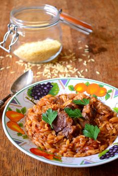 Greek lamb with tomatoes over orzo, via Frugal Feeding -- buy stewing or neck meat for less expense