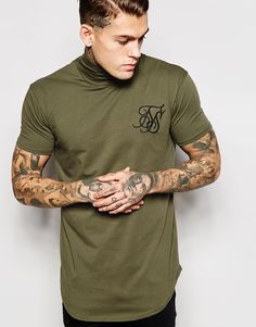 """T-shirt by SikSilk Soft-touch stretch jersey Roll neck Embroidered logo Regular fit - true to size Machine wash 95% Cotton, 5% Elastane Our model wears a size Medium and is 185.5cm/6'1"""" tall"""