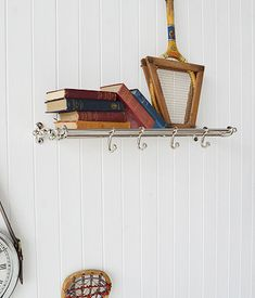 Chrome luggage rail as a coat rack. An elegant vintage style shelf. Resembles a luggage rails from old trains
