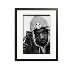 Chuck D of Public Enemy photographed in London in 1987 holding a personal organiser that spells out Mind Revolution.