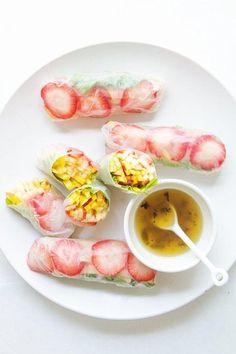Adding these to our must-make summer recipes list now: fruit-filled spring rolls with jalapeño and honey.