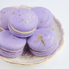 """""""Violet cream macarons, flecked with 24 karat gold - love these @nicolettecostello! {new in the shop today} #sweetbakeshop #macarons"""""""