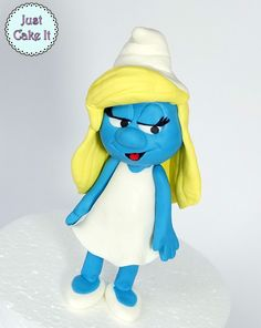 Fondant Smurfette cake topper tutorial here https://www.youtube.com/watch?v=IUjE5BQDTrA