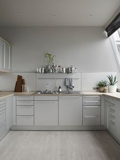 May 2020 - Inspiration for lovely light Scandi kitchens, featuring lots of open shelving ideas, grey units, metro tiles and clever space saving ideas. See more ideas about Minimalist kitchen, Kitchen design and Kitchen interior. Grey Kitchen Cabinets, Kitchen Dining, Kitchen Decor, Kitchen Ideas, Attic Renovation, Attic Remodel, House Ideas, Elegant Kitchens, Attic Rooms