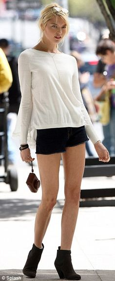 Black and white and stunning all over: Martha sported yet another pair of denim shorts and a long sleeved top for an outfit change