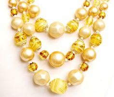 Serendipity treasures present this triple strand #graduated bead necklace. It is marked Japan on the hook clasp. the yellow citron swirl beads are made of glass. The cream f... #necklace #vintage #teamlove #vogueteam