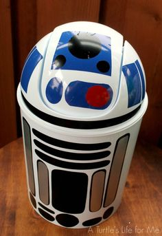 Cheap trashcan with vinyl to look like R2D2! Fun homemade gift for a kid!