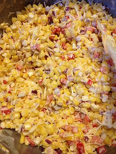 Chili Cheese Frito Corn Salad ~ Great for a potluck! I would have a bowl of crushed fritos on the side so that the whole salad isn't ruined if it's not all eaten at one time.