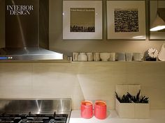 Make Yourself at Home: Cindy Allen Invites You into her Brooklyn Heights Home | The kitchen's ceramic backsplash with framed record albums by Ronald Clyne. #design #interiordesign #interiordesignmagazine #architecture #decor #appliance