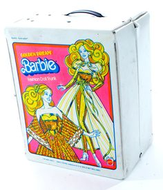 I had this exact Barbie case and the Barbie on the front.  She had gold wire in her hair so you could curl it!