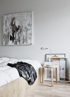 Bedroom with a stool from Artek and the Leaf lamp from Muuto via the Design Files.