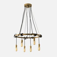 Rounding out our celestial collection, the Tangled Chandelier reflects America's fascination with the night sky. Its sweeping presence, clean lines and raw beauty straddle both midcentury modern and early industrial design. Handcrafted in our Portland factory, the hand-welded brass base is hand finished in classic patina hues to complement both traditional and modern palettes. But its most iconic feature—six exposed bulbs paired with adjustable, braided cloth cords—reflects the organic, unfi...