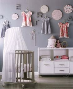 Is this little girls' nursery not just fabulous?  I love the dresses on the wall!