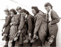 Flight nurses of the 807th Medical Air Evacuation Transport Squadron show their worn-out shoes after returning to Italy, 9 January 1944. On 8 November 1943 a C-53 carrying 13 flight nurses and 13 medics of the 807th MAETS crash-landed in Nazi-occupied Albania. Over the next 2 months, they will all safely escape by foot back to Allied territory.