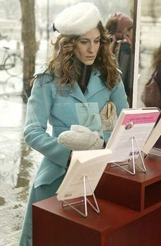 Season Six: Carrie looking incredibly sophisticated while checking out her book in a Paris bookstore.