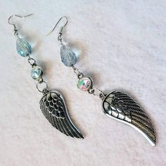 Eva washed her hands and then made her way to the main tent. The last of the convoys was about to leave and she forced more water and food onto every truck that passed - why could men never think of the basics?!?  https://www.etsy.com/listing/626810845/evas-wings-angelic-earrings-with-lots-of