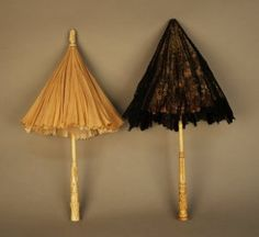 TWO VICTORIAN PARASOLS with CARVED HANDLES. Bone with carved leaf decoration, taupe silk canopy (lacking lace cover). Ivory carved with floral and foliage design with chantilly lace over pink silk canopy.