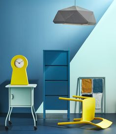 Different IKEA products in shades of blue and yellow are arranged in a studio.