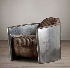 Aviator club chair screams MAN!  Riveted steel + distressed leather = Awesome!