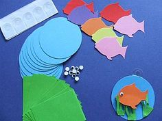 Fish craft idea: Fishy Mini Hanging Collages. Rainbowfish?