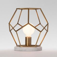 This stylish Project 62 Geometric Brass with Marble Accent Lamp adds class and pizzazz to any modern furnishings. Its aged brass finished steel construction with white marble base will make a great addition to any room.
