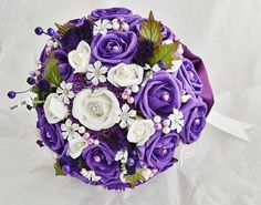 Highland inspired bouquet with purple and white roses, Heather and thistles.