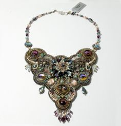 Rainforest is a very unique statement piece combining beadweaving and bead embroidery in the soft water shades of pale green, blue, and silvery