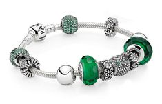 A PANDORA silver bracelet with green Muranos and pavé charms is perfectly on trend this autumn. #jewelry #style #new #aw13