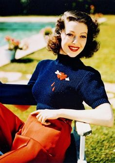 Loretta Young in glorious glamorous technicolor fashions of the late thirties. The bleeding heart pin motif is also seen on Ginger Rogers in a dress for the RKO film, Carefree which puts it about 1938.