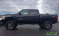 """Chevy with 6"""" lift, N-Fab steps, Hostile wheels, and Toyo A/T II tires. Venom Motorsports - Grand Rapids, Michigan (616) 635-2519 Financing Available"""