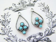 Antiqued Silver Ox Filigree & Turquoise Blue Swarovski Rhinestone Drops Earring Dangles Glass Gems - Pair by alyssabethsvintage on Etsy
