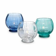 Classic glass globes reflect soothing, watery shades inspired by nature. Set includes one of each color. Use with tealights only, sold separ...