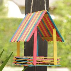 Popsicle stick art Embrace your inner Snow White and bring birds to your backyard with this adorable DIY Popsicle Bird House. Grab some colorful popsicles, hot glue, and start building! Let your little ones help you create this fun craft. Toddler Crafts, Kids Crafts, Diy And Crafts, Arts And Crafts, Decor Crafts, At Home Crafts For Kids, Easy Crafts, Magic Crafts, Family Crafts