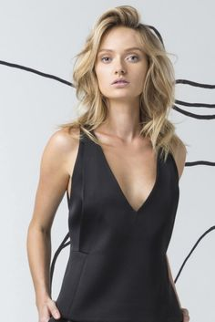 Swing Away Top in Black by Cameo Collective