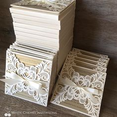 Our popular laser cut {Cinderella} wedding invitations  shown here with an upgrade of a hardcover and boxed envelopes! by whitecherryinvitations