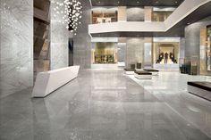 Front Desk // Marvel PRO, Atlas Concorde porcelain floor tiles Noir St. Laurent Matt