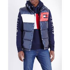 TOMMY JEANS '90s quilted shell gilet ($210) ❤ liked on Polyvore featuring men's fashion, men's clothing, men's outerwear, men's vests, mens sleeveless vest and mens quilted vest