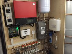 Inside the plant room at Meadow View. (Sunny Boy PV Inverter, Immersun 2, Resol solar thermal pump, Monarch domestic water softener and a whole house UFH system).